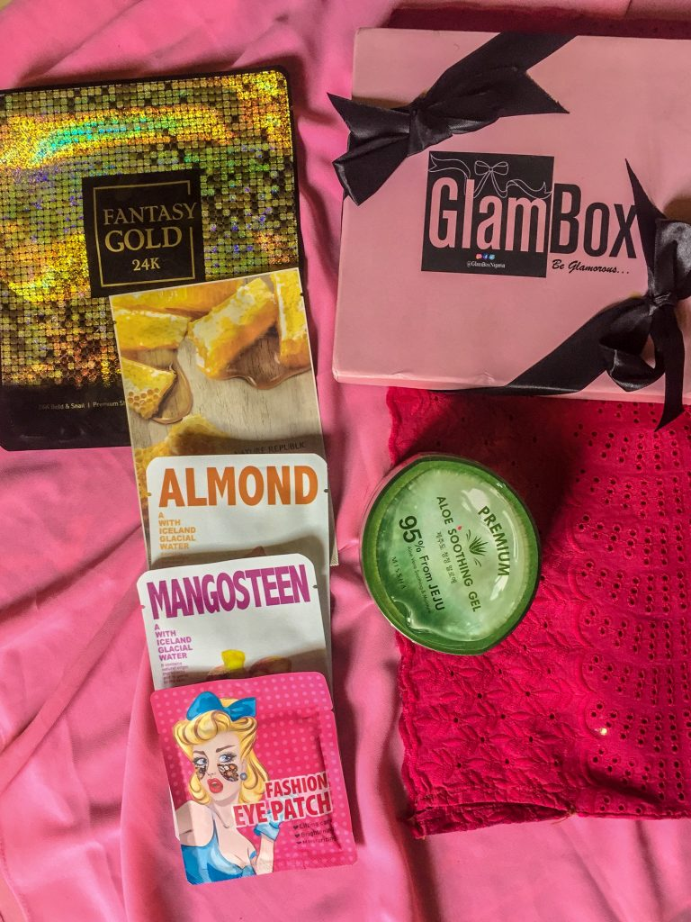 a picture of items received in the glambox Nigeria beauty box + free gift.